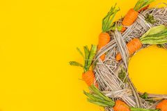 Easter carrots wreath. Easter carrots wreath on a yellow background stock image