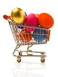 The easter cart. Many multi-coloured Easter eggs in the small store cart Royalty Free Stock Image