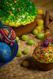 Easter celebrating cake, color eggs, straw backgrounds, food holidays photography. Easter celebrating family dinner, multicolored eggs, flowers, sweet sprinkled Royalty Free Stock Photo