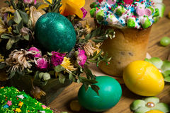 Easter celebrating family dinner, color eggs, cakes, fruit tea, sweets Stock Photo