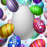 Easter celebration Blank Egg. Concept as a group of flying decorated eggs with one large white egg as a symbol for spring festive message communication Royalty Free Stock Image