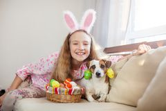 Child is holding a basket with Easter eggs Stock Images