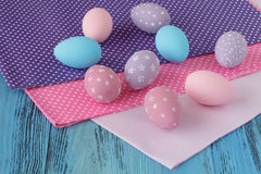 Easter celebration with colored eggs and festive cloth Royalty Free Stock Images