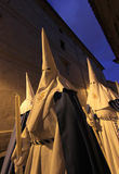 Easter celebrations during holy week. Penitents wearing white hoods seen during easter celebrations amongst downtown palma de mallorcas streets in the island of Stock Photos