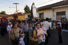 Easter celebrations in León, Nicaragua. León, Nicaragua - April 14, 2014: People in a procession in the streets of the city of León in Nicaruagua during stock images