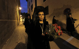 Easter celebrations in mallorca. Women wearing spanish typical mantilla dress walk the streets during easter celebrations downtown palma de mallorcas main Stock Image