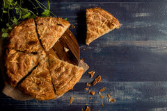 Easter cheese pie. Sliced double cheese pie on wooden background with copy space Royalty Free Stock Images