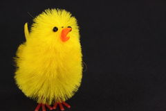 Easter chick. Yellow, cute and fluffy man made easter chick Stock Image