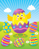 Easter Chick Hatching from Egg. Cartoon illustration of a baby chick hatching from a colored Easter egg, while standing on a grassy hill, with other colored eggs Stock Photo