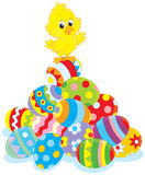 Easter Chick. Little yellow chick on top of a pile of painted Easter eggs Royalty Free Stock Photography