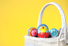 Easter chick painted on an egg shell peeking out Stock Photo