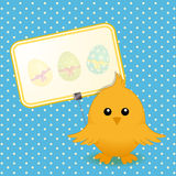 Easter chick and sign on blue background Royalty Free Stock Photo