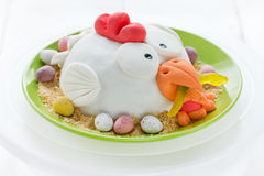 Easter chicken cake decorated fondant and chocolate candy eggs. Easter chicken cake decorated fondant , chocolate candy eggs and cookies crumbs royalty free stock image