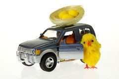 Easter chicken at car with nest on the roof. Easter chicken at toy car with nest on the roof Stock Photos