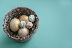 Easter chicken eggs in a basket with hay. royalty free stock photo