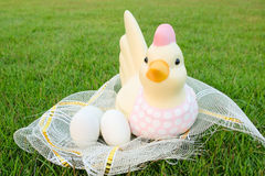 Easter, Chicken and eggs in the net Royalty Free Stock Images