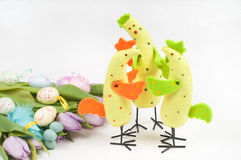 Easter chicken family with tulips and eggs Stock Photo