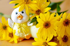 Easter chicken and flowers Stock Photography