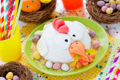 Easter chicken fondant cake on festive decorated table. Easter food idea for kids , Easter colorful food composition stock images