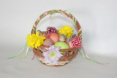 Happy Easter painted colored eggs basket flowers Royalty Free Stock Photo