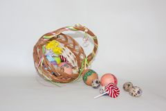 Happy Easter painted colored eggs basket flowers Stock Images