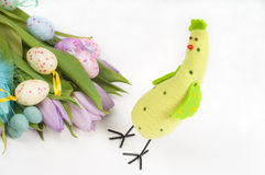 Easter chicken with tulips and eggs Royalty Free Stock Photo