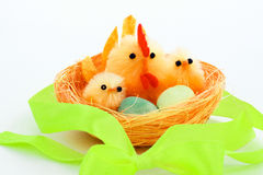 Easter chickens and hen in a nest. With a bow from a tape Royalty Free Stock Photography