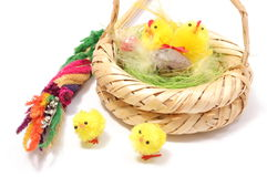 Easter chickens in wicker basket and colorful palm Royalty Free Stock Photography