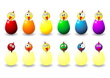 Easter chicks. And eggs with different faces colors and positions Royalty Free Stock Photo