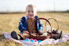 Easter Chicks in a Basket. Little boy on an Easter egg hunt with chicks and eggs in his basket Stock Photo