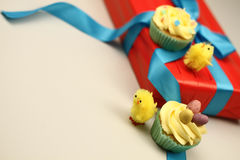 Easter chicks with cakes Royalty Free Stock Image