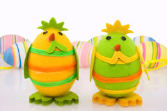 Easter chicks and colorful eggs Stock Image