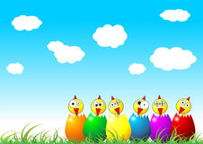 Easter chicks on grass. Easter chicks and eggs on grass over cloudy blue sky Stock Photography