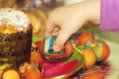 Easter. Child's hand holding decorated  easter egg Royalty Free Stock Photo