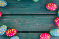 Chocolate easter eggs, green bench, easter background stock image