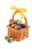 Easter chocolate in a basket. Isolated on white Studio shot Stock Images