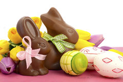 Easter chocolate bunny rabbits with pink, white and green eggs Royalty Free Stock Photos
