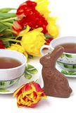 Easter chocolate bunny, tulips and tea Royalty Free Stock Photos