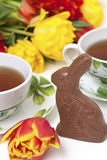Easter chocolate bunny, tulips, tea royalty free stock photo