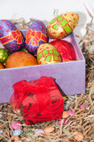 Easter chocolate and chicken eggs in pink box in the nest Stock Photos