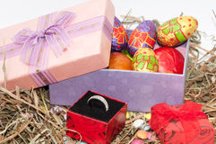 Easter chocolate and chicken eggs in pink box in the nest with g Royalty Free Stock Image