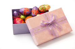 Easter chocolate and chicken eggs in pink box on the white backg Stock Photos