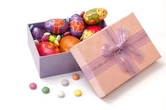 Easter chocolate and chicken eggs in pink box on the white backg Stock Images