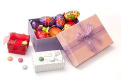 Easter chocolate and chicken eggs in pink box on the white backg Stock Image