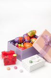 Easter chocolate and chicken eggs in pink box on the white backg Royalty Free Stock Photography