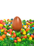 Easter chocolate egg and caramels on the green grass Stock Photo