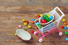 Easter chocolate egg, colorful candy on wooden table stock photography