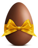 Easter chocolate egg with golden ribbon bow Royalty Free Stock Photography