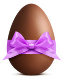 Easter chocolate egg with purple ribbon bow stock images