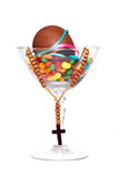 Easter chocolate egg , sweets and cross in a glass Royalty Free Stock Photos